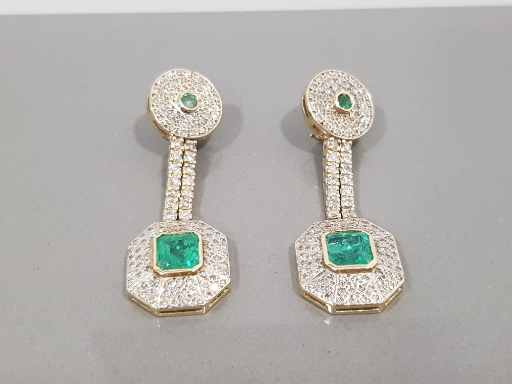 14CT YELLOW GOLD EMERALD AND DIAMOND DROP EARRINGS COMPRISING OF A CIRCLE DIAMOND WITH EMERALD