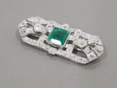 PLATINUM DIAMOND AND EMERALD ORNATE BROOCH COMPRISING 4CT PRINCESS CUT EMERALD AND 6CT CLUSTER OF