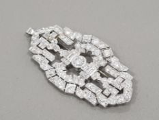 PLATINUM DIAMOND SET ORNATE BROOCH APPROXIMATELY 9CT IN TOTAL COMPRISING 2 EMERALD CUT DIAMONDS