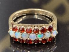 A 9CT YELLOW GOLD OPAL AND GARNET RING SIZE N 3.3G GROSS