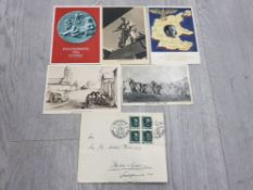 THIRD REICH WARTIME PROPAGANDA CARDS AND AN ENVELOPE WITH HITLER STAMPS USED AT NUREMBERG IN 1937