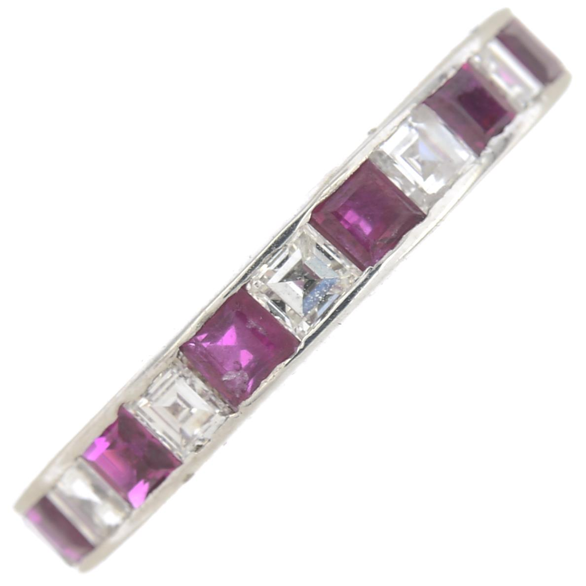 Lot 361 - A square-shape ruby and diamond full eternity ring.