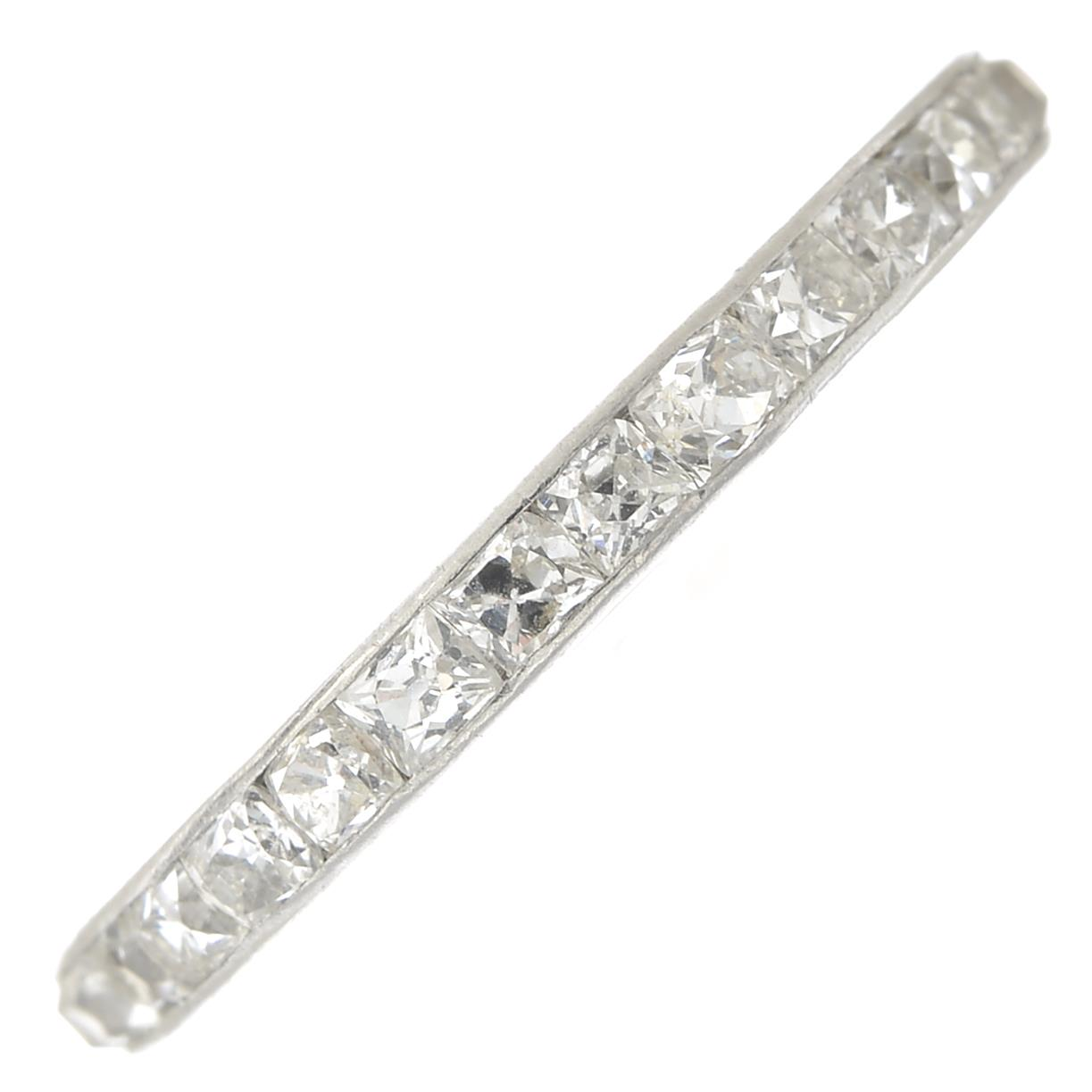 Lot 15 - An early 20th century platinum square-shape old-cut diamond full eternity ring,