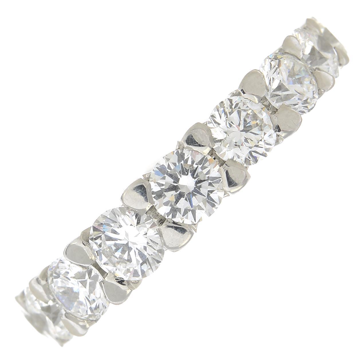 Lot 60 - A brilliant-cut diamond tapered full eternity ring.