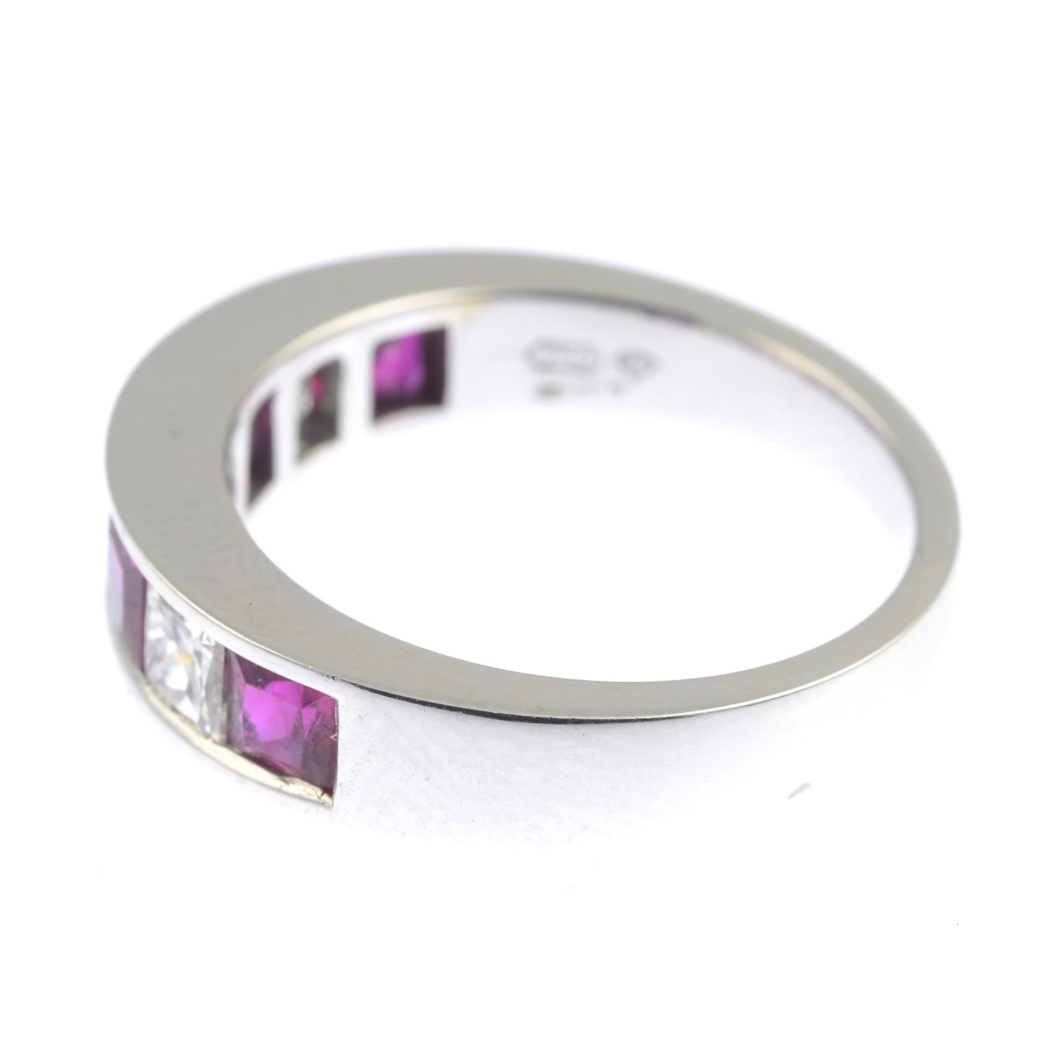 Lot 345 - An 18ct gold square-shape ruby and diamond half eternity ring.