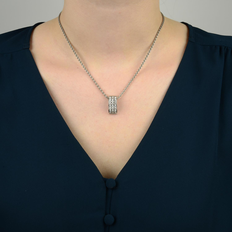 Lot 344 - An 18ct gold diamond pendant,