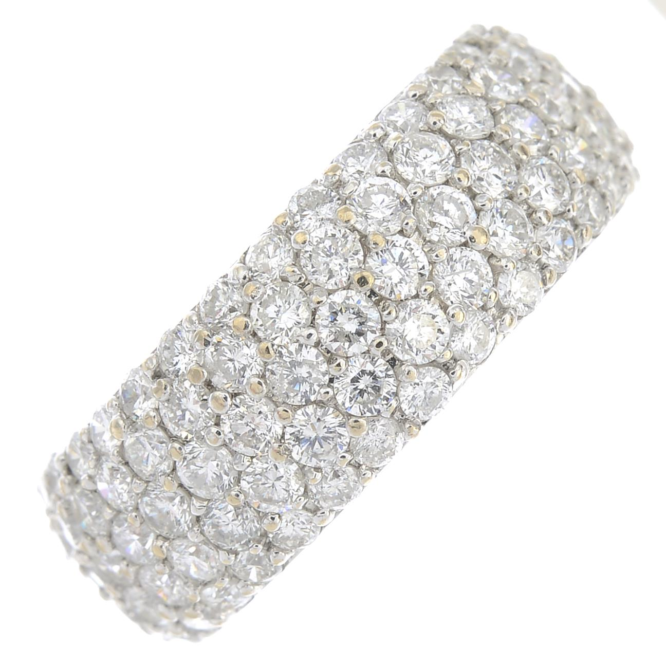 Lot 80 - An 18ct gold pave-set diamond full eternity ring.Estimated total diamond weight 4.25cts,