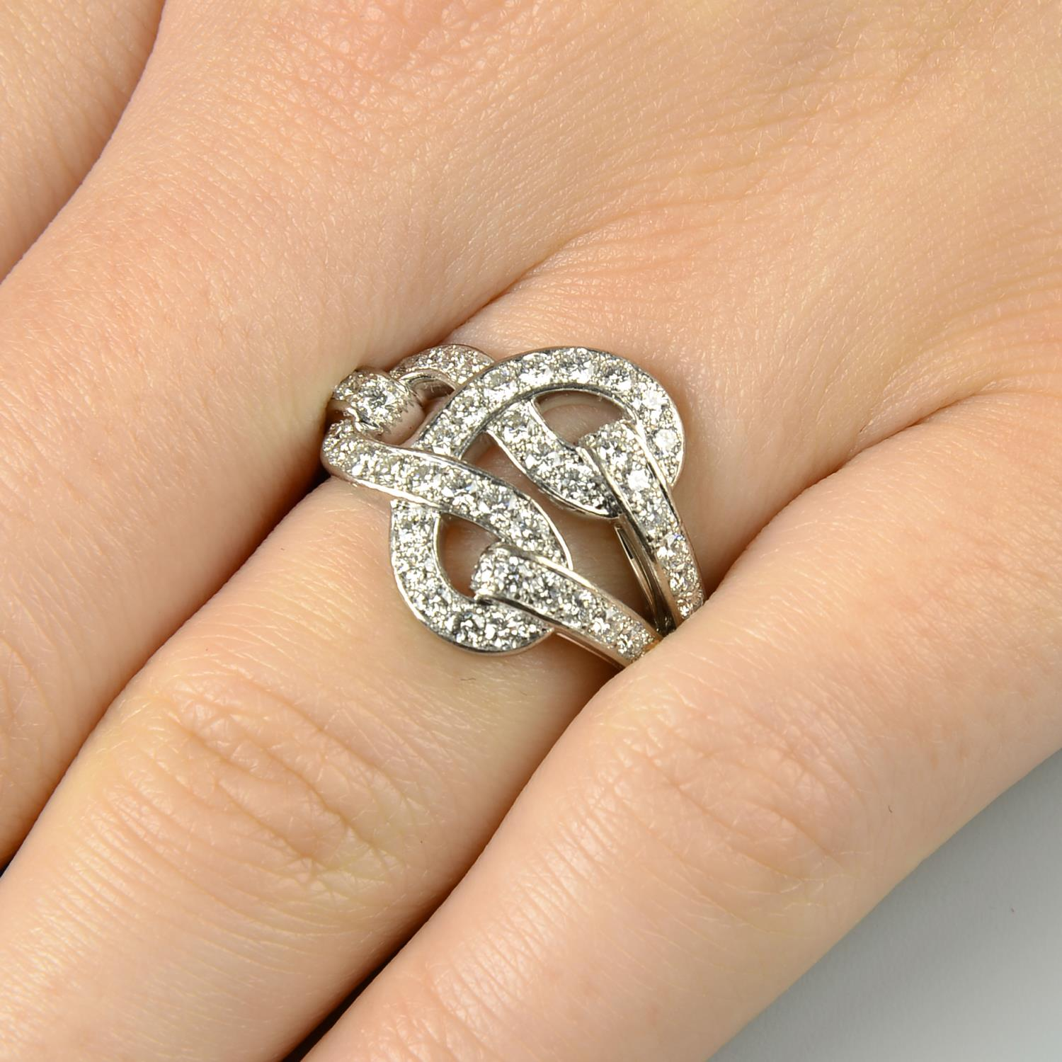 Lot 142 - An 18ct gold diamond 'Agrafe' ring,