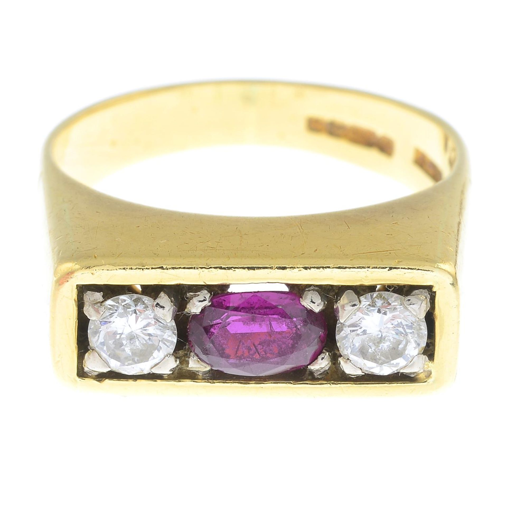 An 18ct gold ruby and brilliant-cut diamond three-stone ring.
