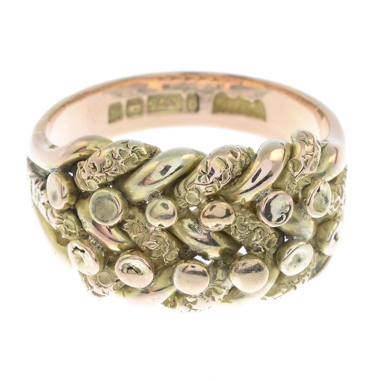 A gentleman's 9ct gold keeper ring.Hallmarks for Birmingham, 1971.Ring size U.