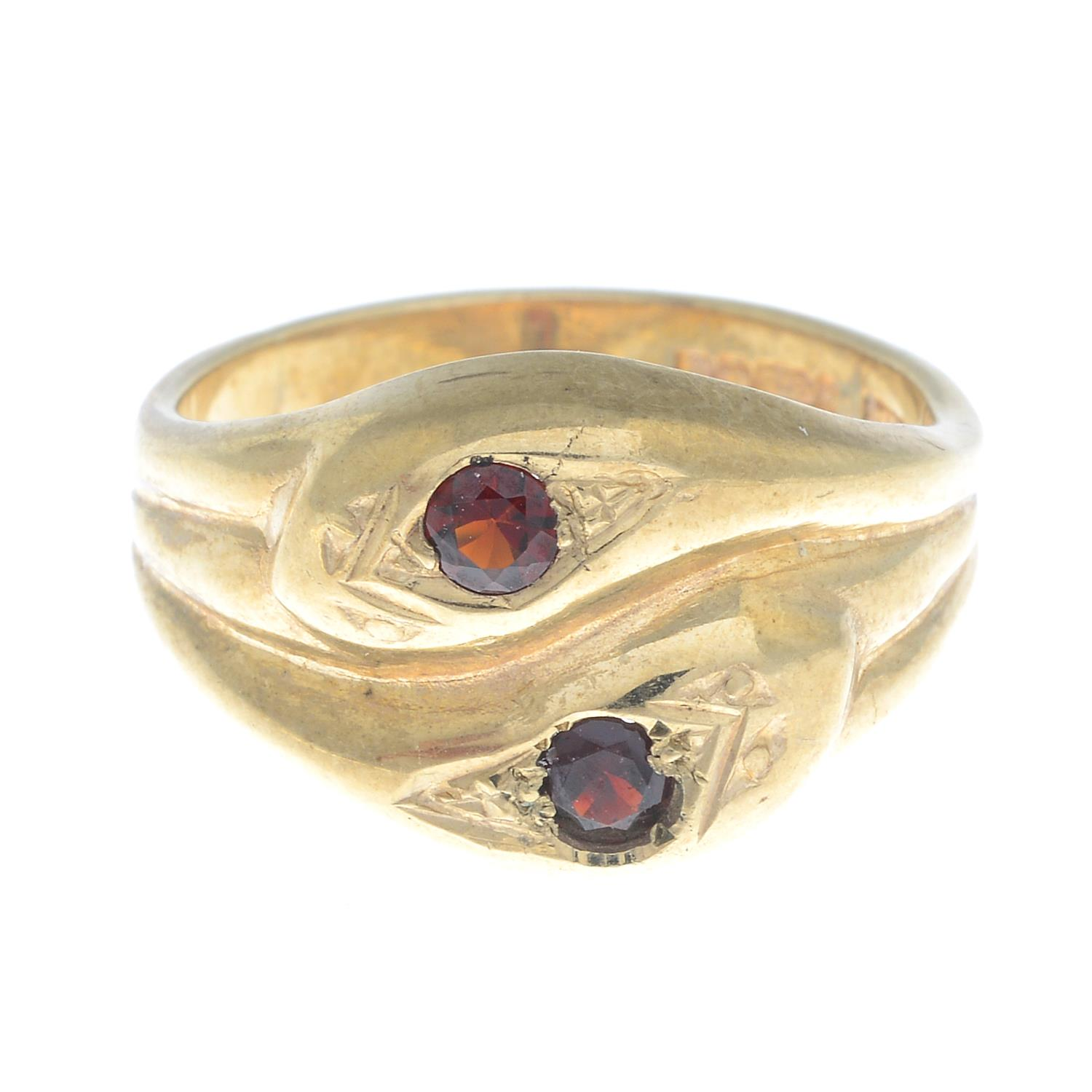 A 9ct gold snake ring, with red gem crest highlights.Hallmarks for 9ct gold.