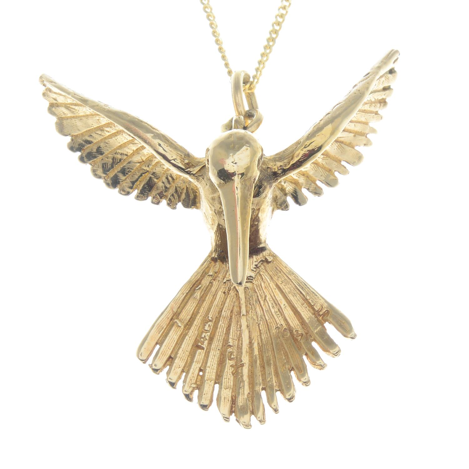 A pendant, depicting a textured hummingbird in flight, with 9ct gold chain.