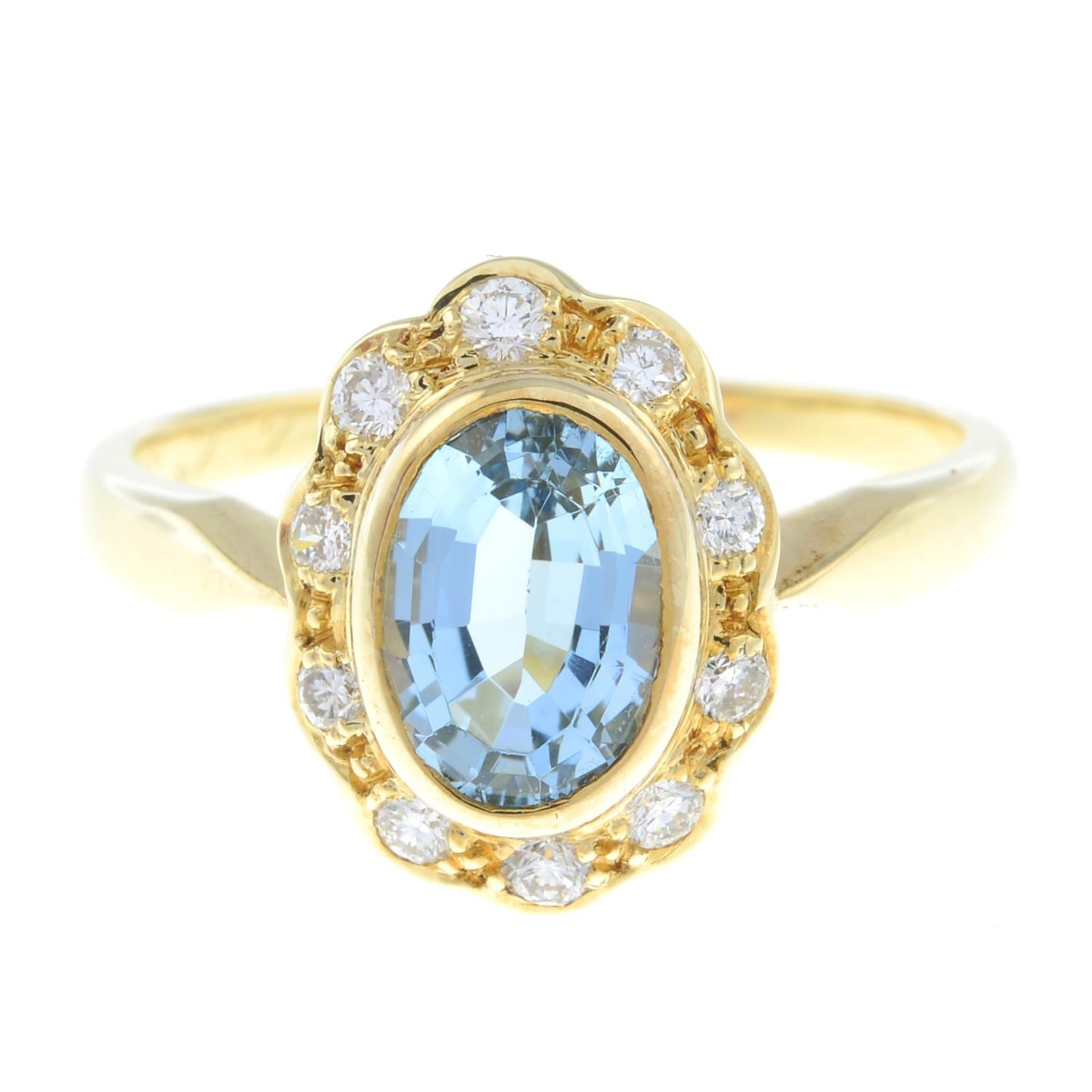 An aquamarine and brilliant-cut diamond cluster ring.Total diamond weight 0.21ct,