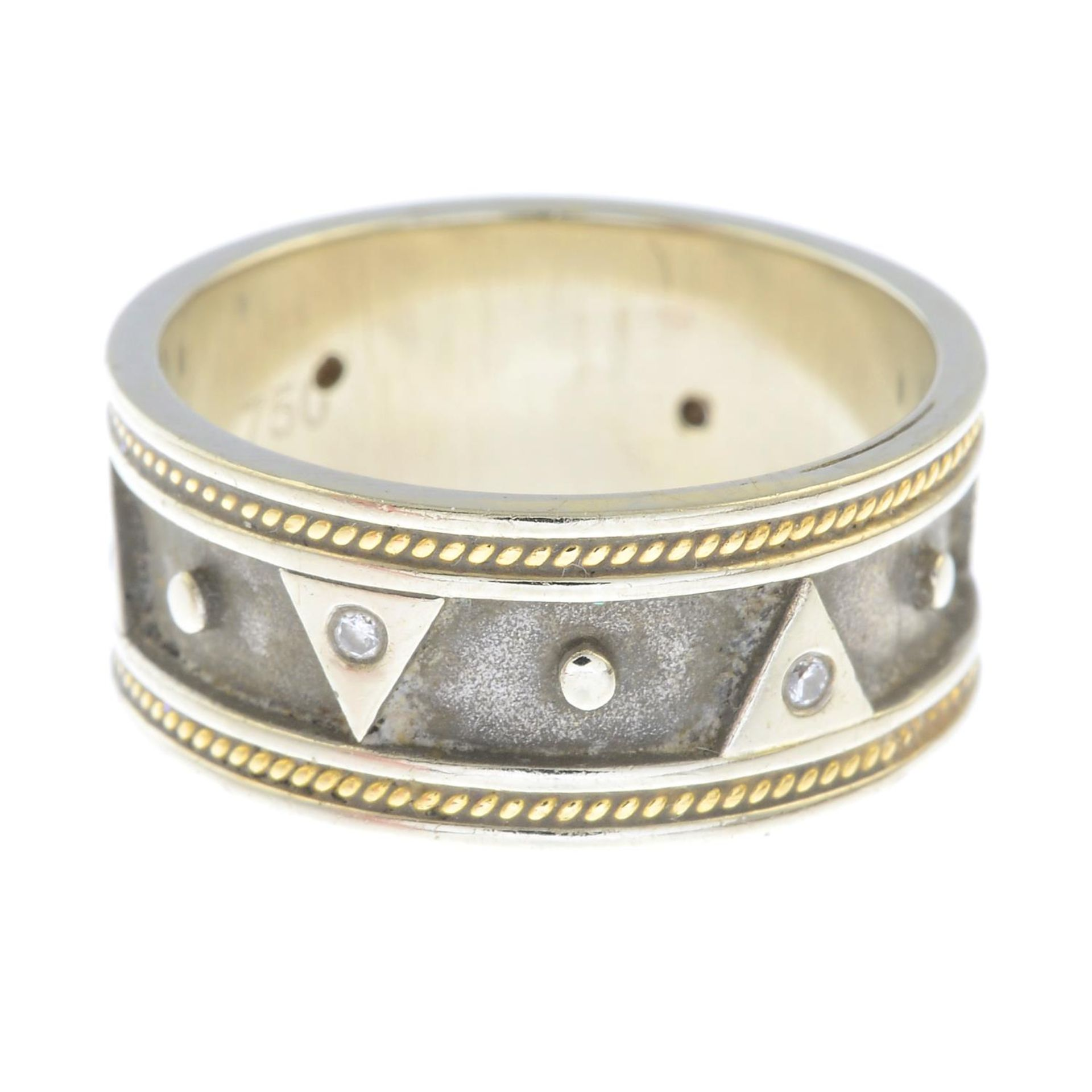 An 18ct gold brilliant-cut diamond band ring.Hallmarks for Birmingham.Ring size P1/2.