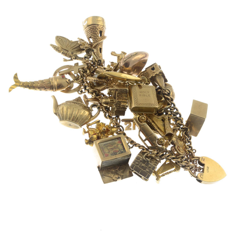 A charm bracelet, suspending thirty charms.Bracelet stamped 15 625. - Bild 2 aus 2