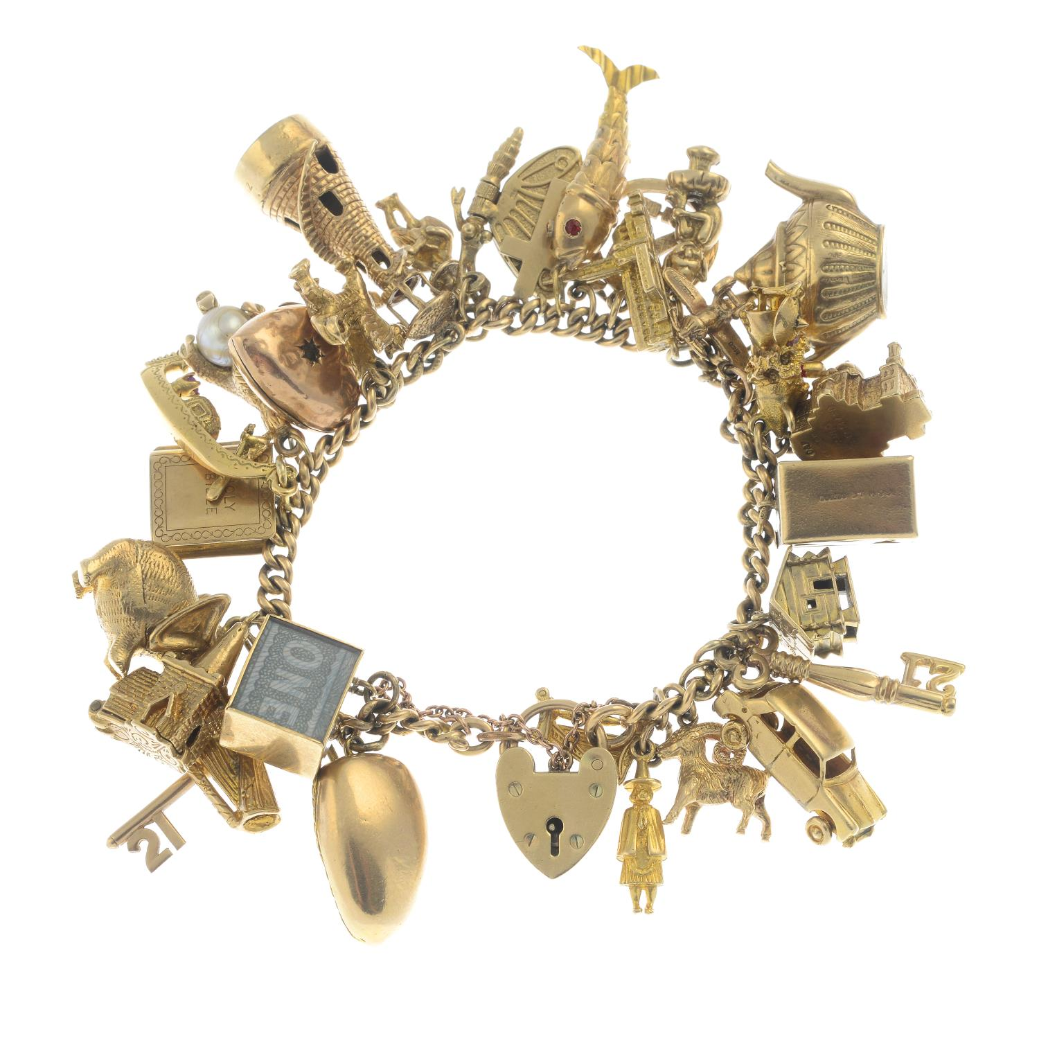 A charm bracelet, suspending thirty charms.Bracelet stamped 15 625.