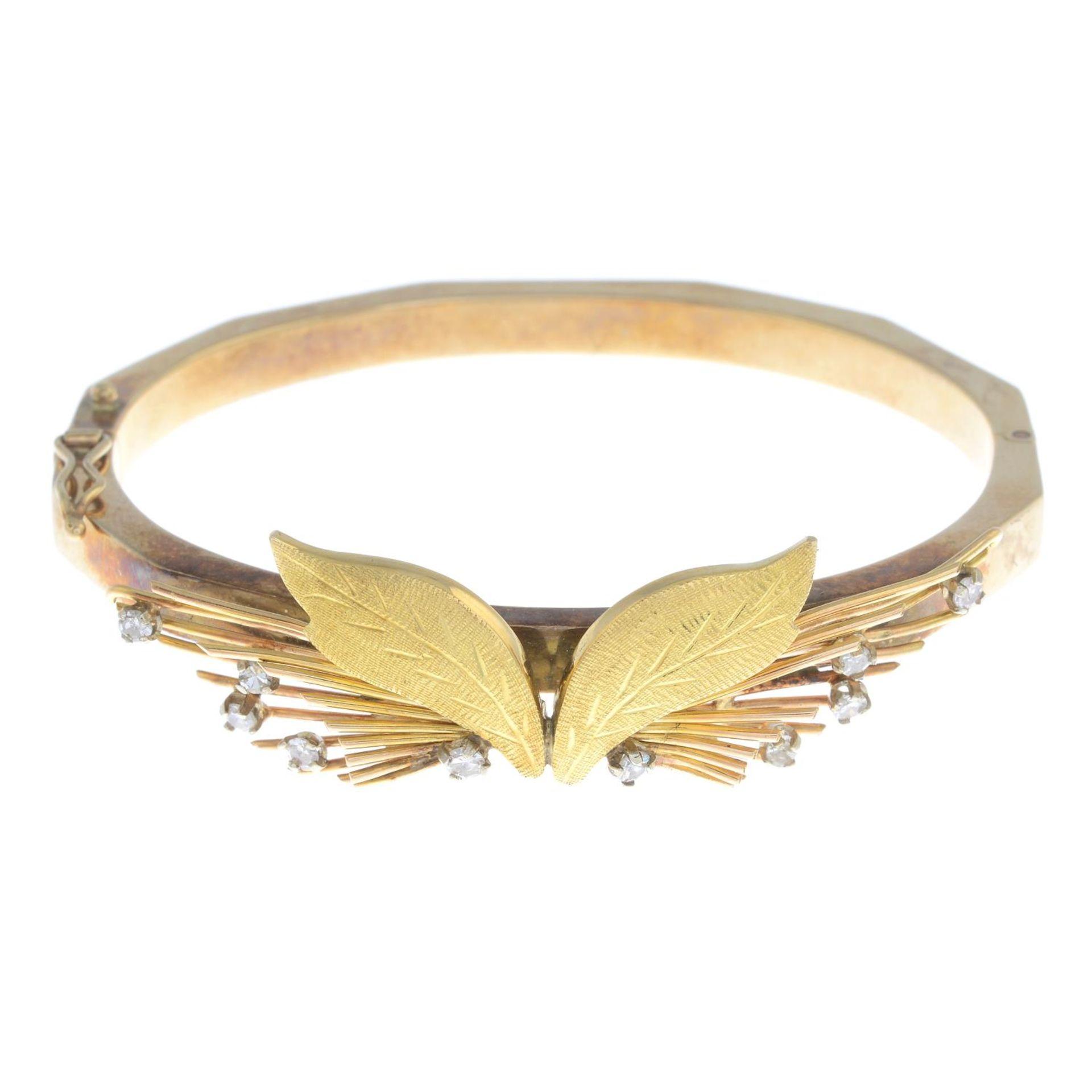 A 9ct gold diamond bi-colour bangle,