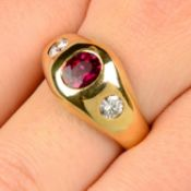 A ruby and brilliant-cut diamond three-stone ring.Ruby calculated weight 0.91ct,