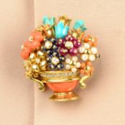 A coral, turquoise, diamond, ruby, sapphire and seed pearl floral bouquet brooch.