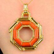 A coral and diamond pendant.