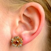 A pair of 18ct gold ruby and brilliant-cut diamond floral cluster earrings.Total ruby weight