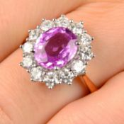 An 18ct gold pink sapphire and brilliant-cut diamond cluster ring.