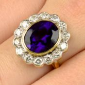 An 18ct gold amethyst and brilliant-cut diamond cluster ring.Amethyst calculated weight 3.78cts,