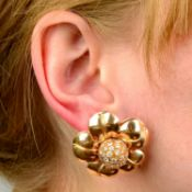 A pair of mid 20th century 18ct gold diamond floral earrings.Estimated total diamond weight