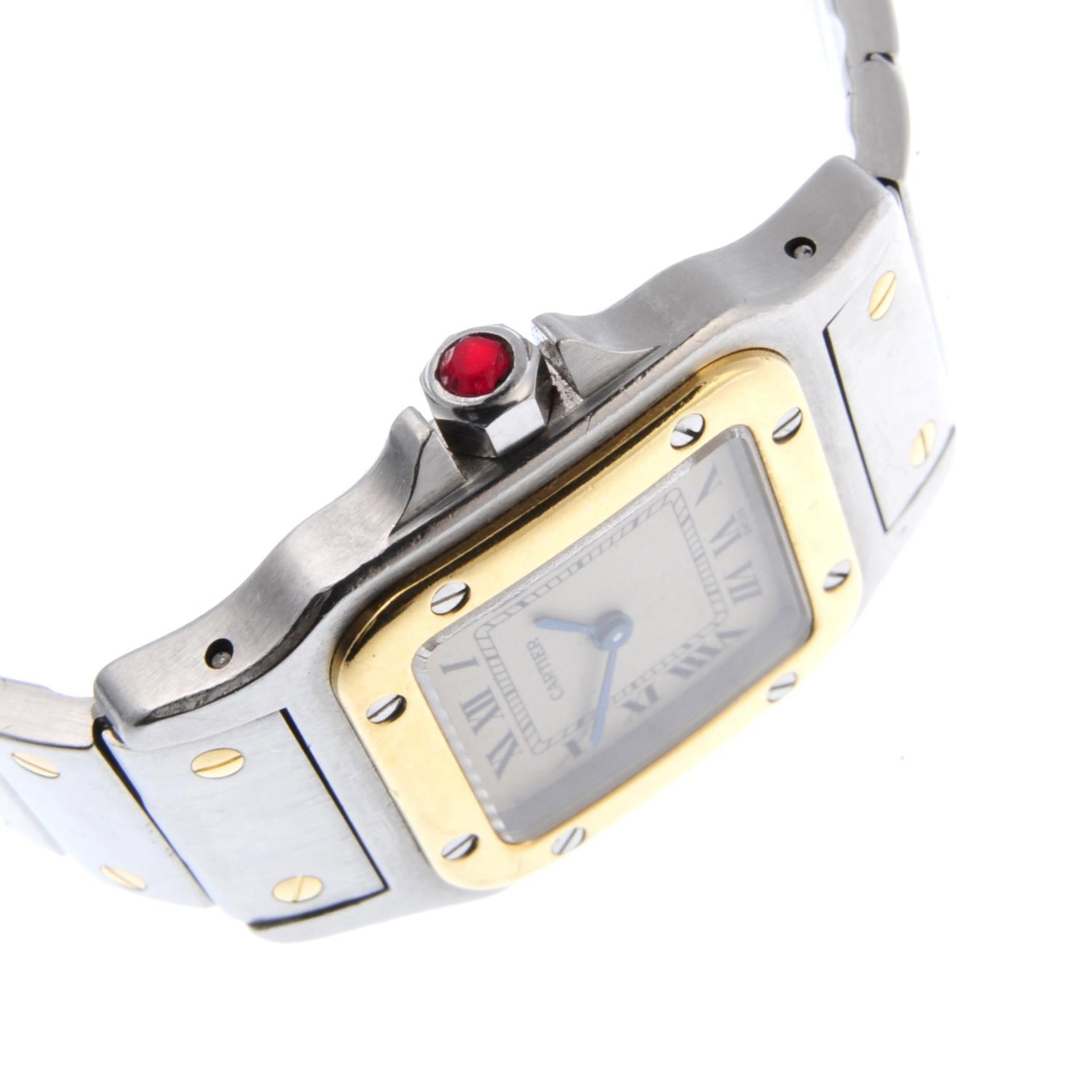Los 22 - CARTIER - a lady's Santos bracelet watch.