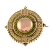 A late 19th century gold target brooch.Length 3.6cms.