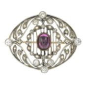 An Edwardian gold and platinum ruby and diamond brooch.Length 3cms.