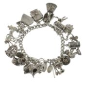 A silver charm bracelet, a further charm bracelet and assorted charms.Hallmarks for Birmingham.