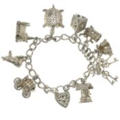 Two silver charm bracelets and assorted charms.Hallmarks for Birmingham and London.Lengths 18 and