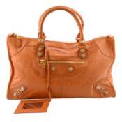 BALENCIAGA - an orange Giant Work handbag.
