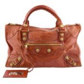BALENCIAGA - a dark orange Giant Work handbag.