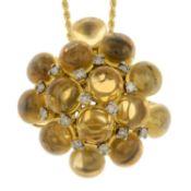 A circular citrine cabochon and brilliant-cut diamond cluster pendant,