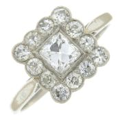 A vari-cut diamond cluster ring.Estimated total diamond weight 0.75ct,