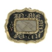 An early Victorian black enamel memorial brooch.May be worn as a pendant.