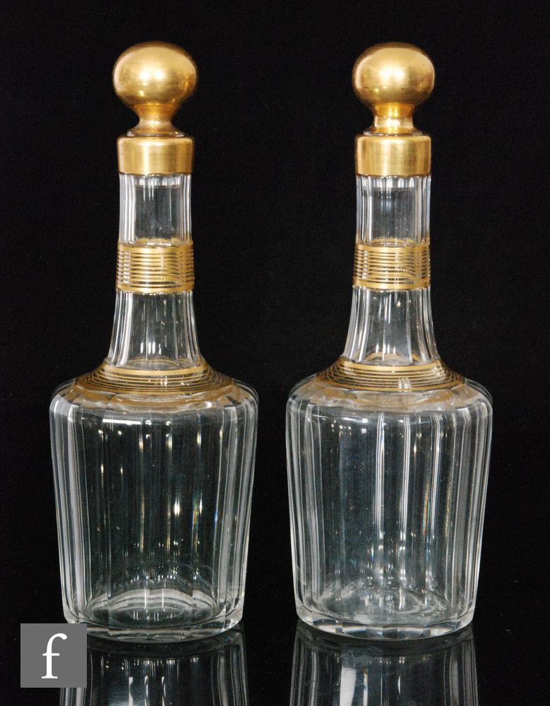A pair of late 19th Century Baccarat crystal spirit decanters of slice cut shouldered form with a