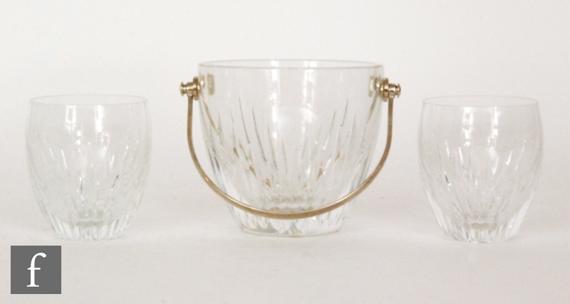 A 20th Century Baccarat clear crystal ice bucket of barrel form with stepped mitre cuts beneath a