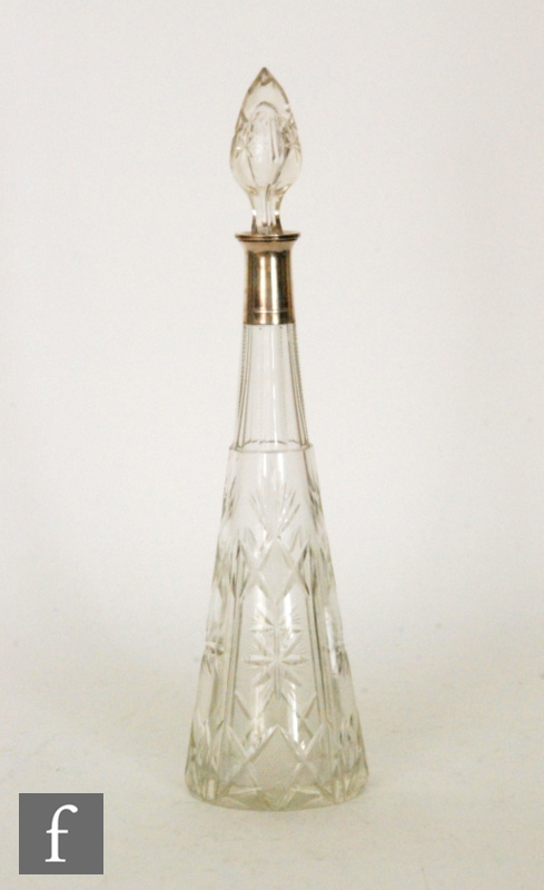 A large early 20th Century French clear crystal decanter in the manner of Baccarat, of slender