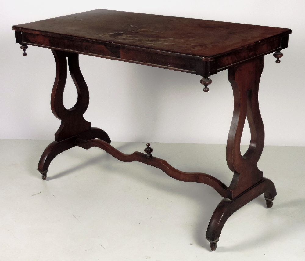 Lot 10 - A Victorian rectangular walnut Side or Hall Table, on lyre supports, united by stretcher.