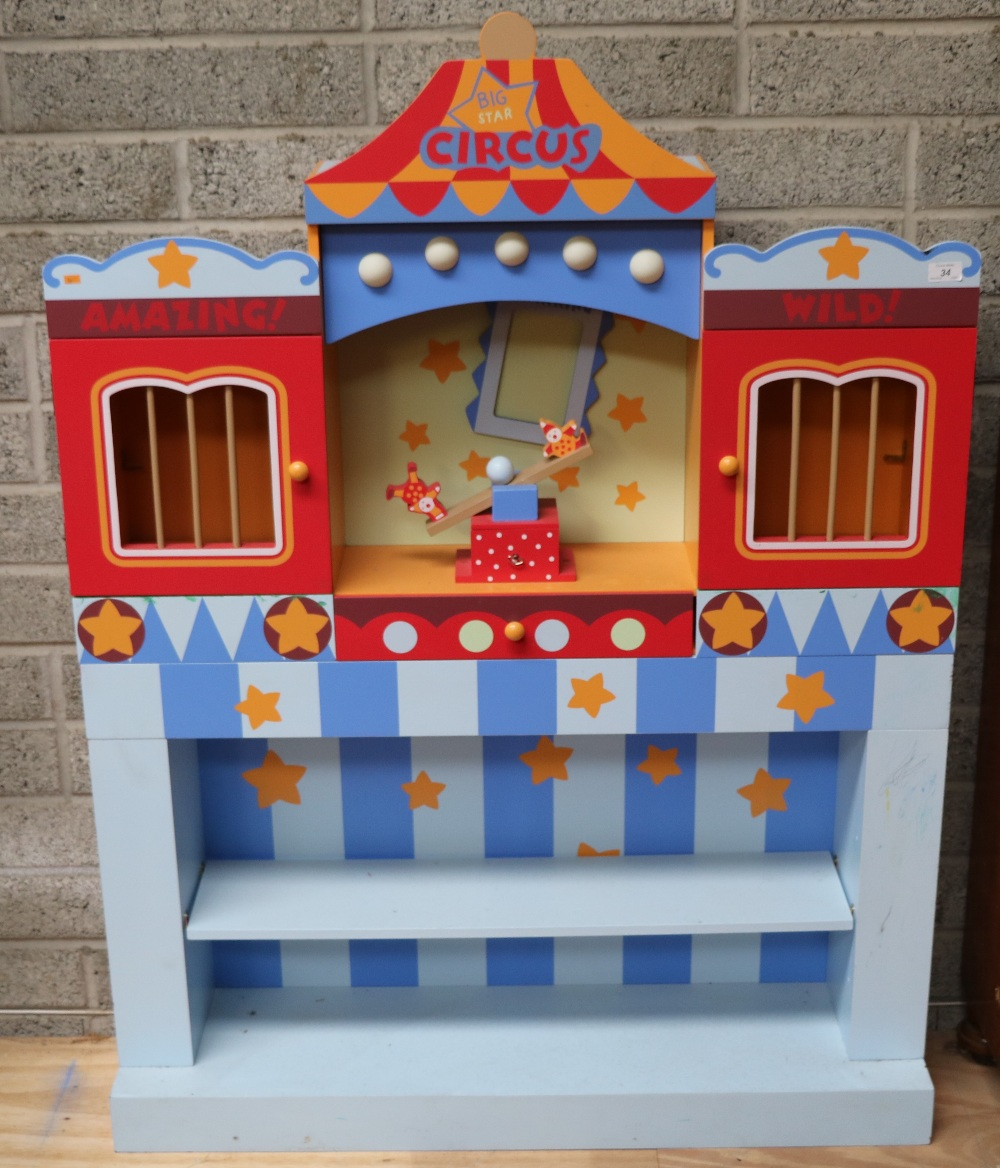 Lot 34 - A Children's painted wooden Bookshelf, modelled as a circus.