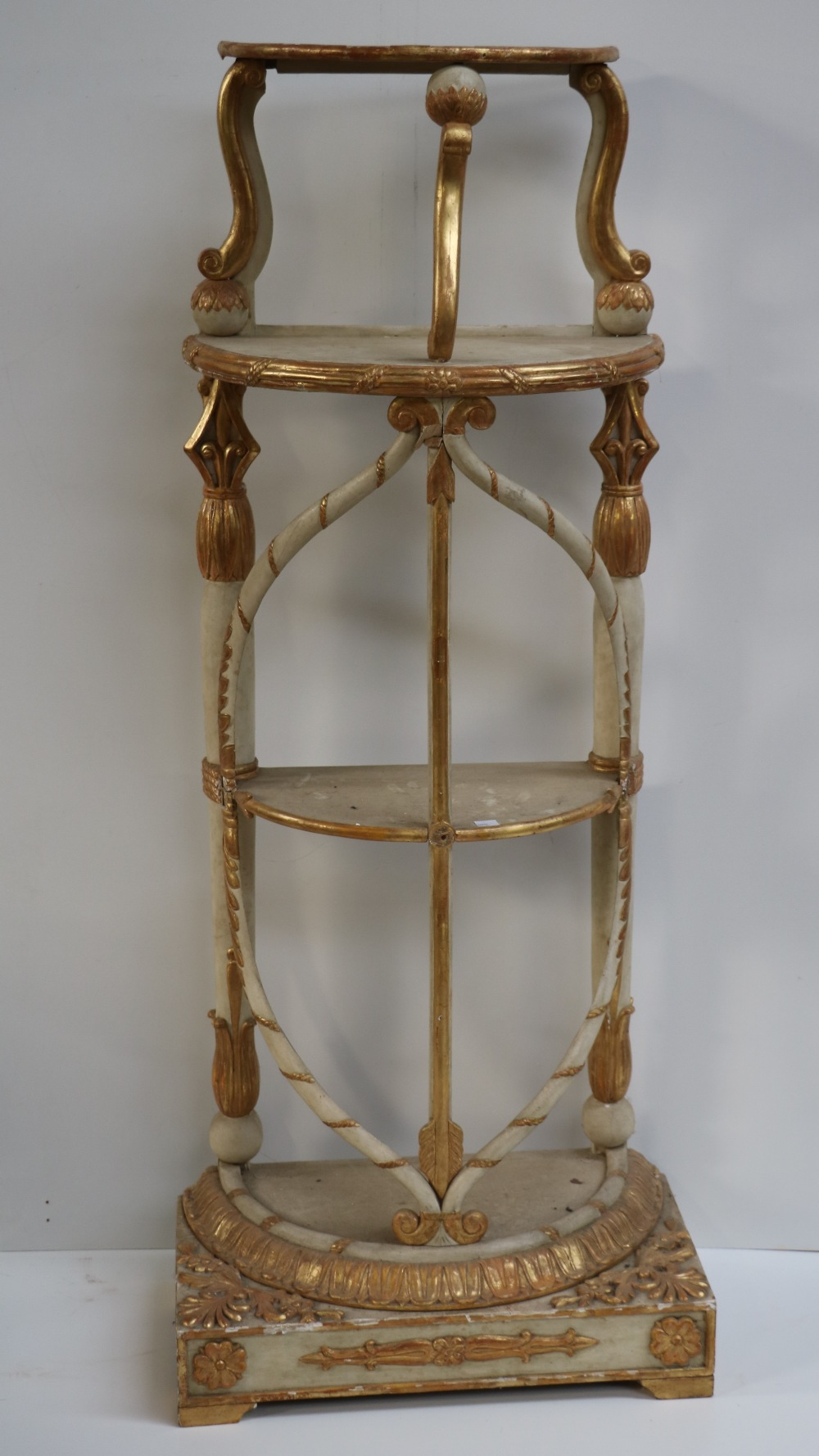 Lot 16 - An unusual carved painted and gilt four tier Stand.