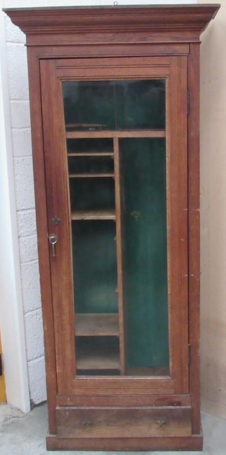 Lot 25 - An Edwardian oak Gun Cabinet, the moulded cornice enclosing a secret compartment,