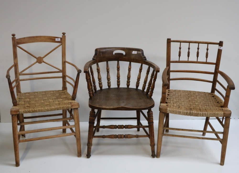 Lot 56 - Two attractive similar beech Elbow Chairs, with twined seats,