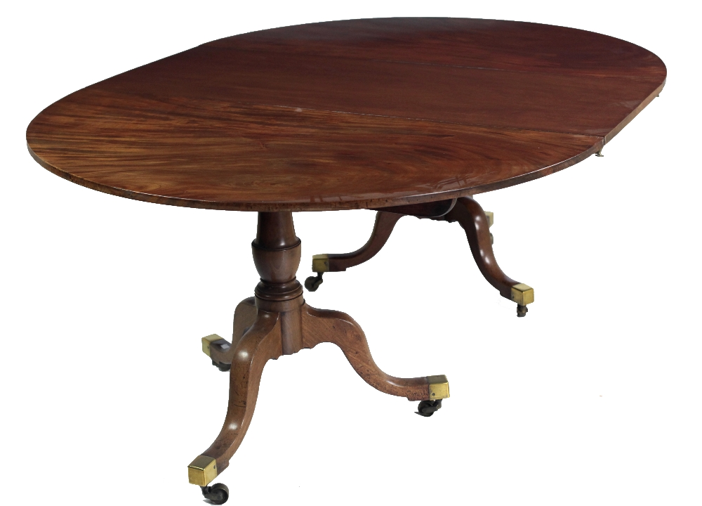 Lot 3 - An early 19th Century mahogany two pod Dining Table, and extra leaf,