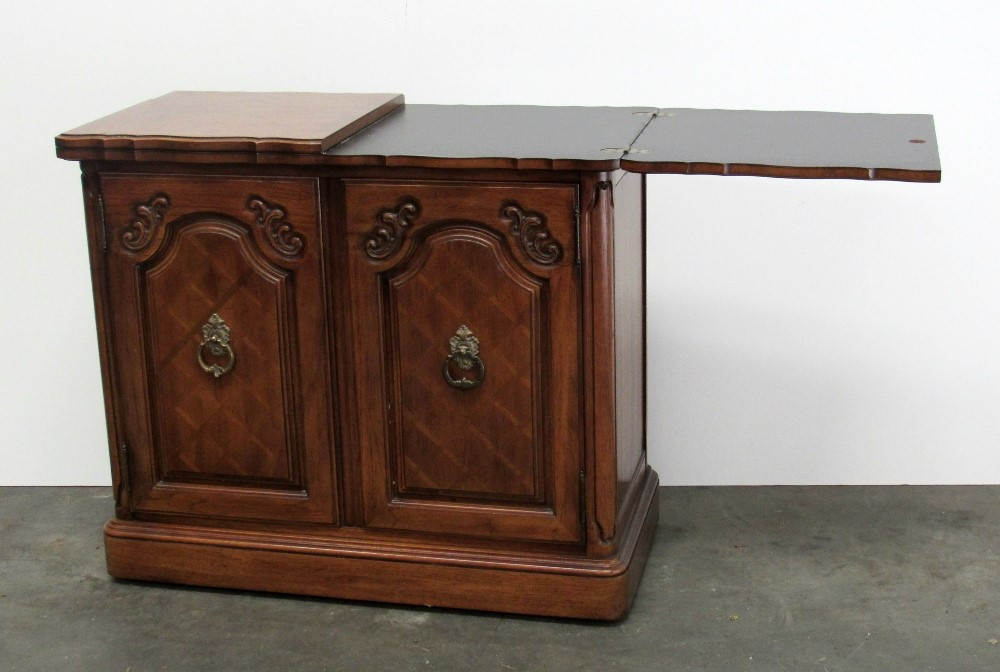 Lot 116 - A Louis XV style walnut Side Cabinet / Buffet with hinged top over solid cupboard doors on a plinth