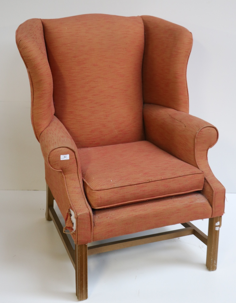 Lot 54 - A large modern wing back Armchair, covered in speckled red material.