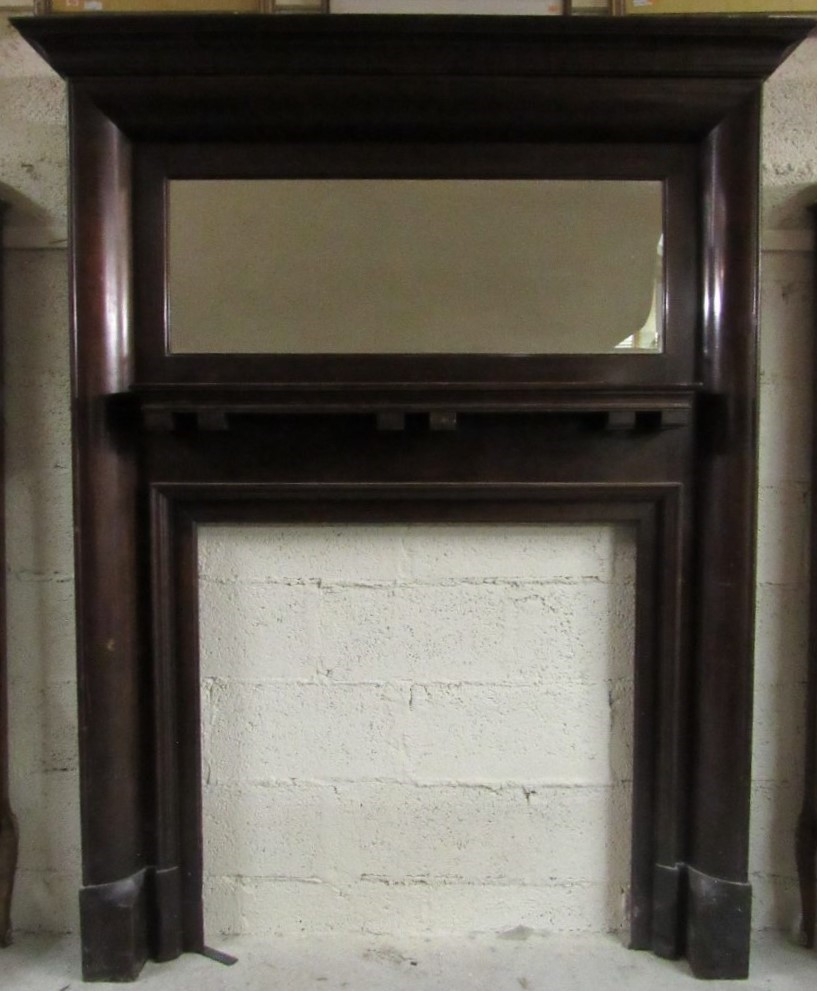 Lot 26 - A good quality early 20th Century mahogany Arts & Crafts Fire Surround, with bevelled mirror inset,